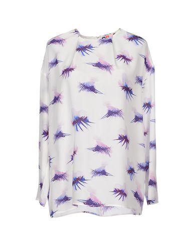 Фото - Женскую блузку MSGM белого цвета
