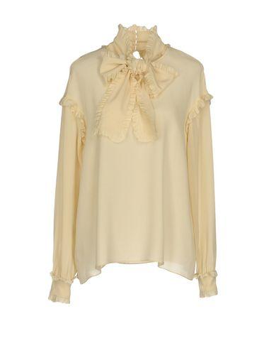 Фото - Женскую блузку  бежевого цвета