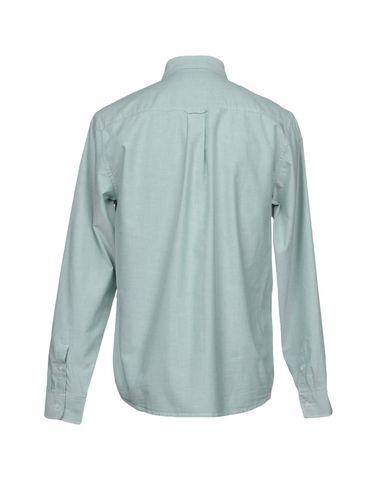 Фото 2 - Pубашка от CARHARTT светло-зеленого цвета
