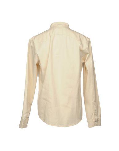 Фото 2 - Pубашка от EDWIN бежевого цвета
