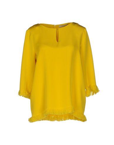 Фото - Женскую блузку  желтого цвета