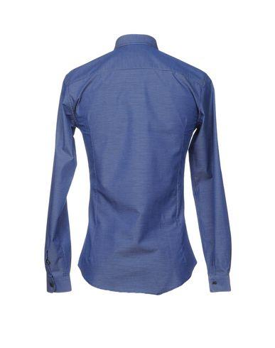 Фото 2 - Pубашка от NEILL KATTER синего цвета