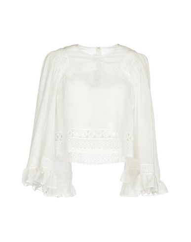 Фото - Женскую блузку McQ Alexander McQueen белого цвета