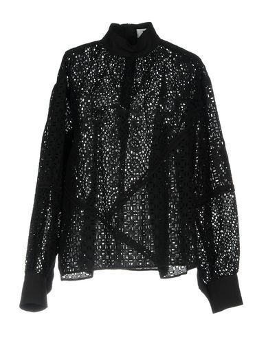 Фото - Женскую блузку MSGM черного цвета