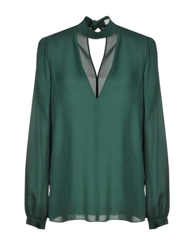 Фото - Женскую блузку A.L.C. зеленого цвета