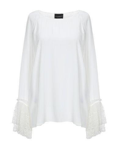 Фото - Женскую блузку  белого цвета