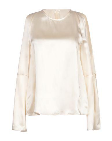 Фото - Женскую блузку JUCCA бежевого цвета