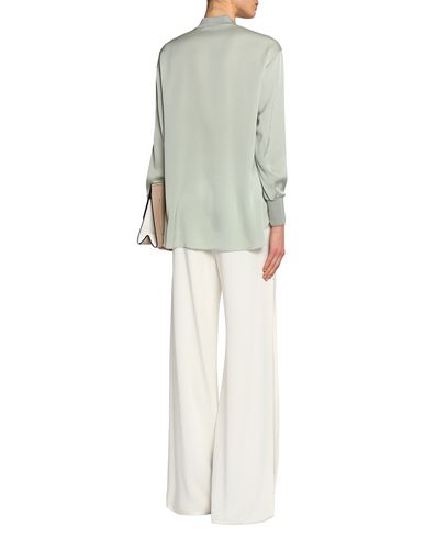 Фото 2 - Женскую блузку  светло-зеленого цвета