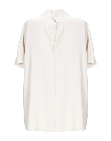 Фото 2 - Женскую блузку  бежевого цвета