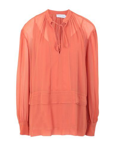 Купить Женскую блузку  оранжевого цвета