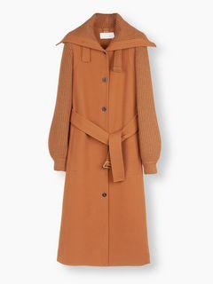 Manteau à manches en maille
