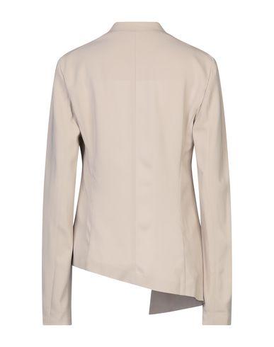 Фото 2 - Женский пиджак  бежевого цвета