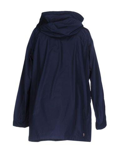 Фото 2 - Женский пуховик  темно-синего цвета