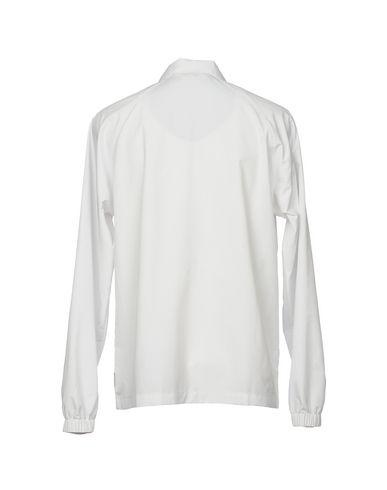 Фото 2 - Мужскую куртку  белого цвета