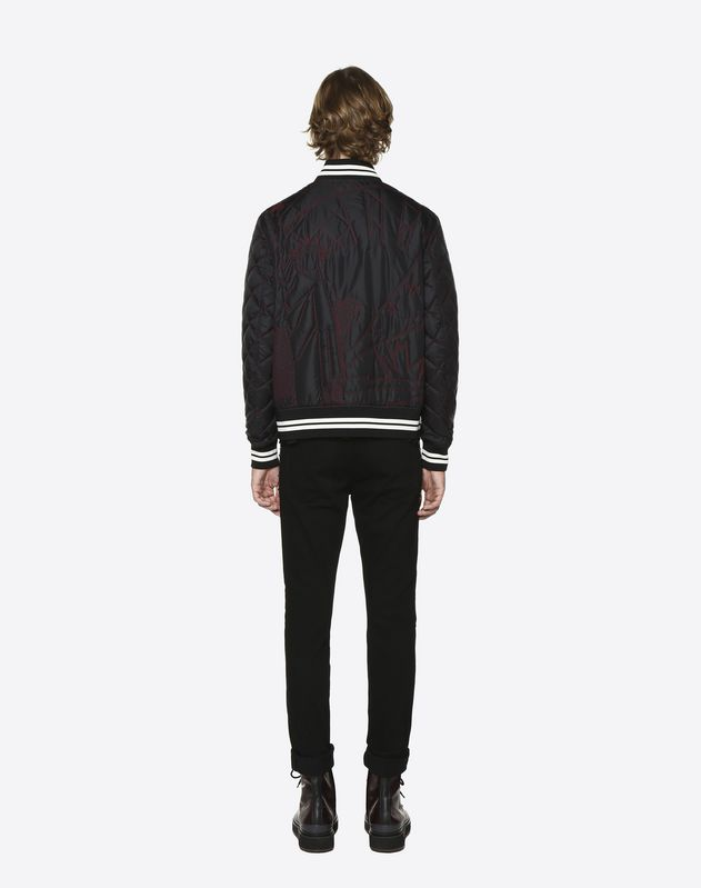 Short quilted blouson with New York embroidery