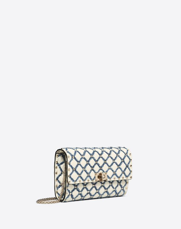 Rockstud Spike crossbody clutch with denim detail