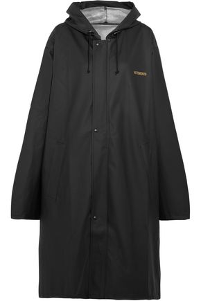 VETEMENTS Printed waxed PVC hooded coat