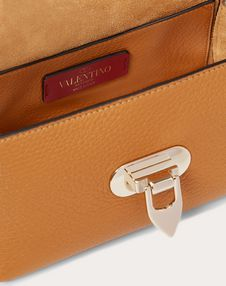 Mini Rockstud Grainy Leather Crossbody Bag