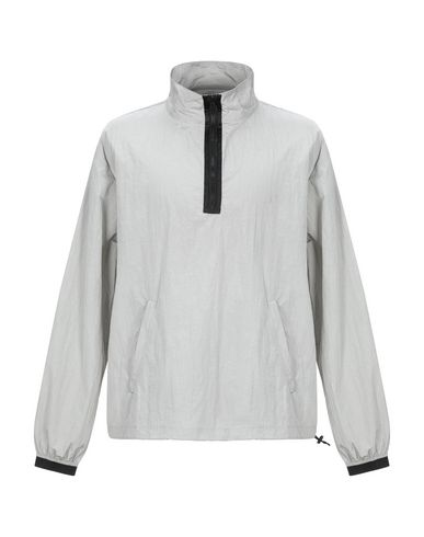 Фото - Мужскую куртку  светло-серого цвета