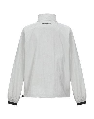 Фото 2 - Мужскую куртку  светло-серого цвета