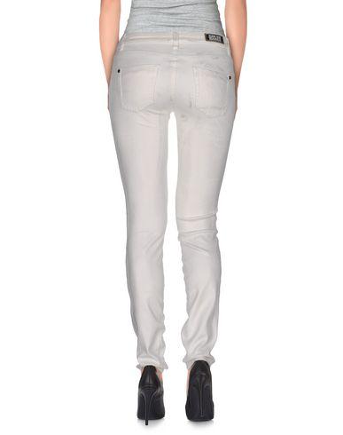 Фото 2 - Джинсовые брюки белого цвета
