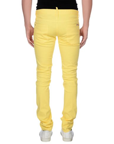 Фото 2 - Джинсовые брюки желтого цвета