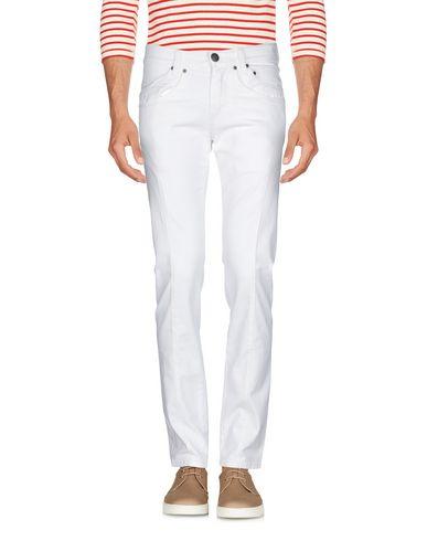 Фото 2 - Джинсовые брюки от ERMANNO DI ERMANNO SCERVINO белого цвета