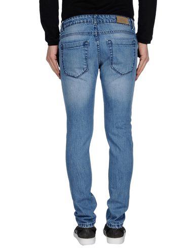 Фото 2 - Джинсовые брюки от ETC. синего цвета