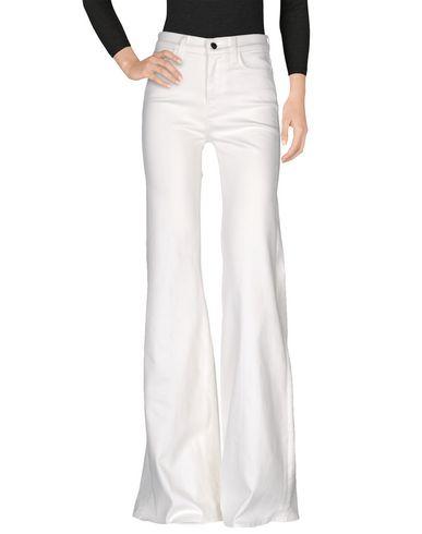 Джинсовые брюки GIAMBATTISTA VALLI for 7 FOR ALL MANKIND 42511505KW