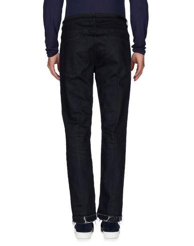 Фото 2 - Джинсовые брюки от GUNS DISARMED синего цвета