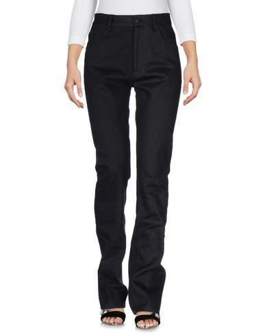 Фото - Джинсовые брюки от KOSTAS MURKUDIS черного цвета