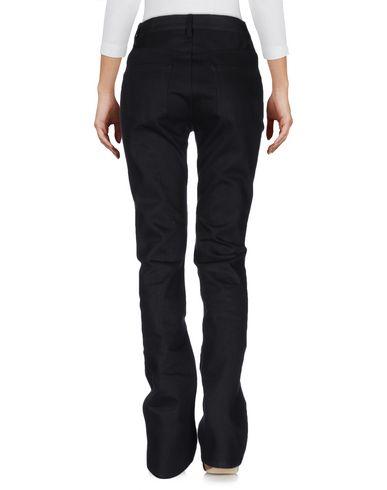 Фото 2 - Джинсовые брюки от KOSTAS MURKUDIS черного цвета