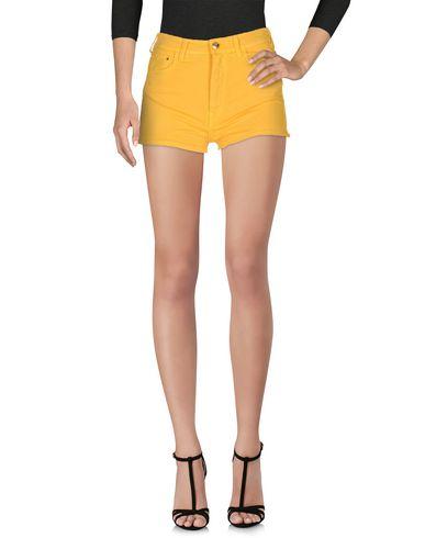 Фото - Джинсовые шорты желтого цвета