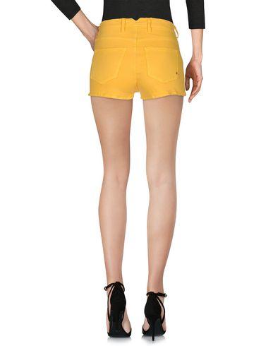Фото 2 - Джинсовые шорты желтого цвета