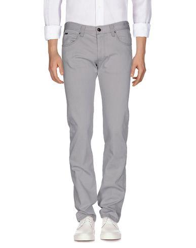 Джинсовые брюки ARMANI COLLEZIONI 42556038DC