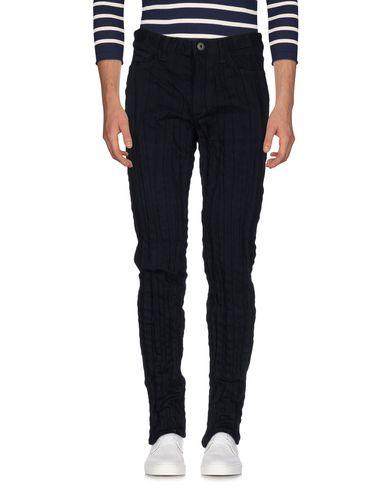 Джинсовые брюки ISSEY MIYAKE MEN 42569642RB