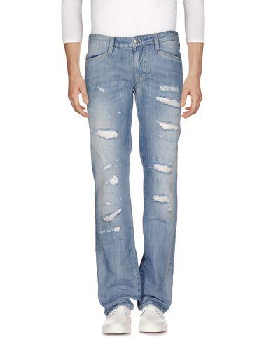 Джинсовые брюки VERSUS 42574412LW