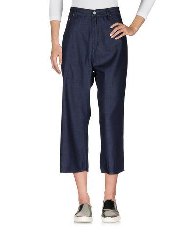 Джинсовые брюки-капри CHEAP MONDAY 42576822LH
