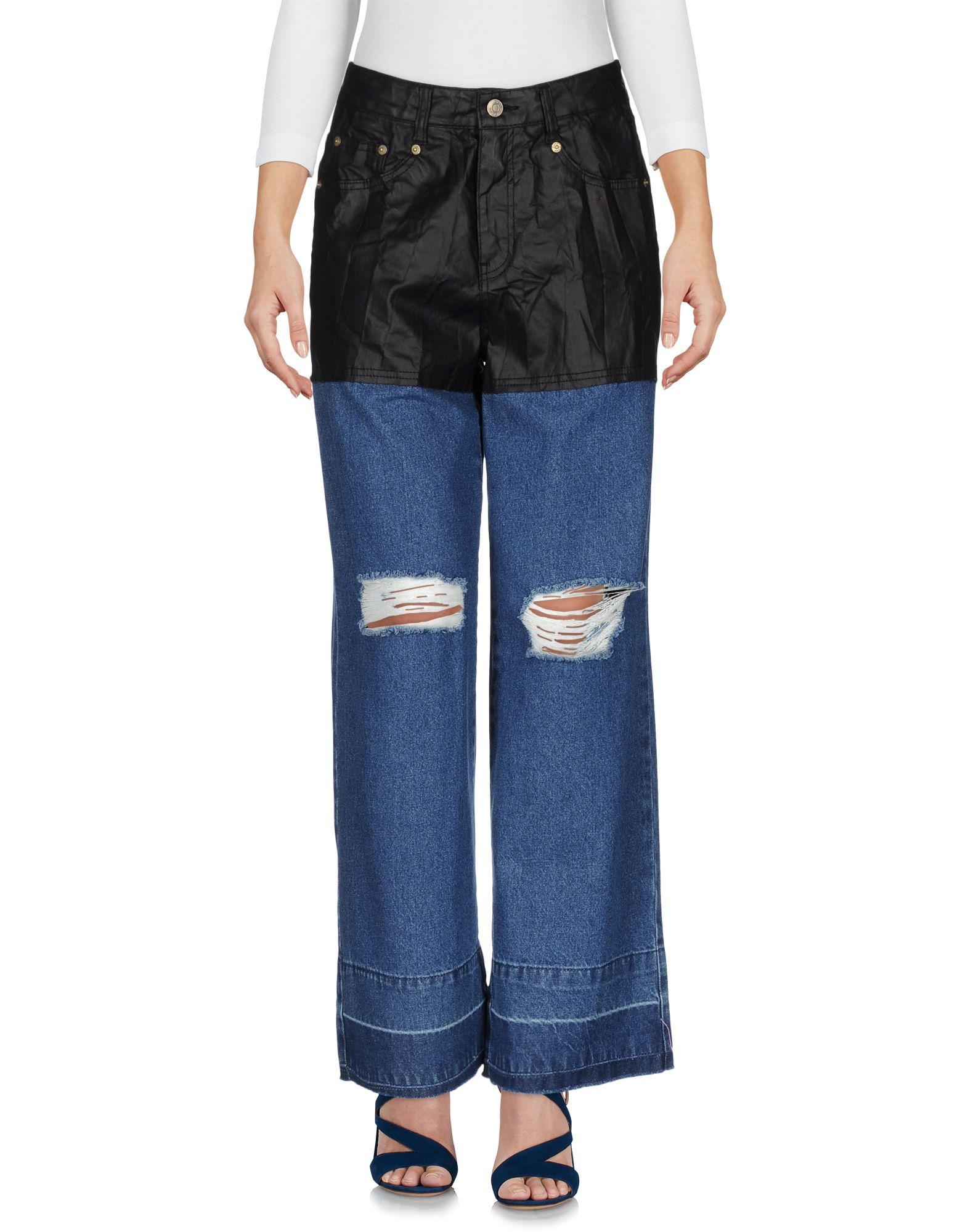 купить SJYP Джинсовые брюки по цене 6950 рублей