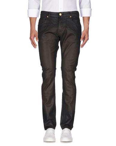 Джинсовые брюки PIERRE BALMAIN 42585204TQ