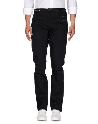 Джинсовые брюки SAINT LAURENT 42593185XR