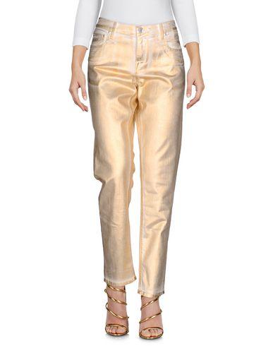Фото - Джинсовые брюки золотистого цвета