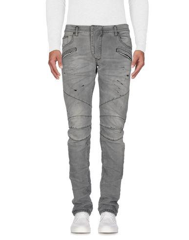 Джинсовые брюки PIERRE BALMAIN 42606293KO