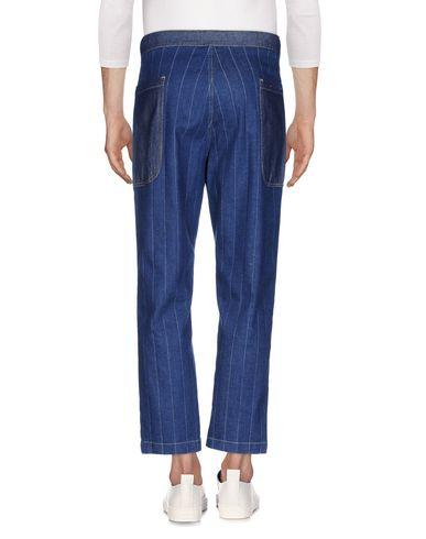 Фото 2 - Джинсовые брюки от WHITE SAND 88 синего цвета
