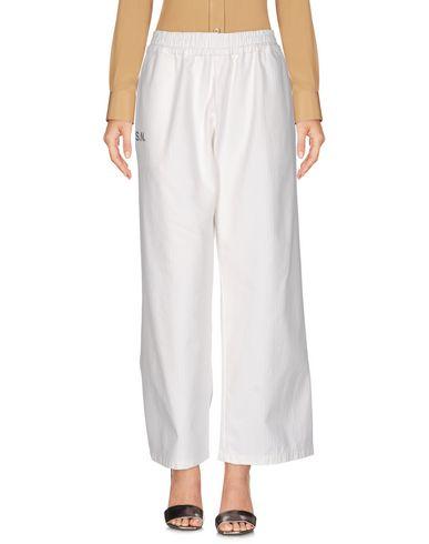 Купить Повседневные брюки от THE SEAFARER белого цвета
