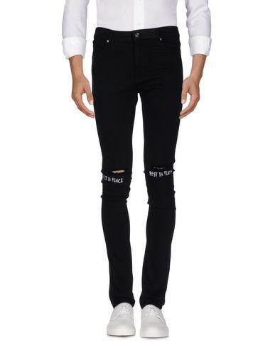 Фото - Джинсовые брюки от RTA черного цвета