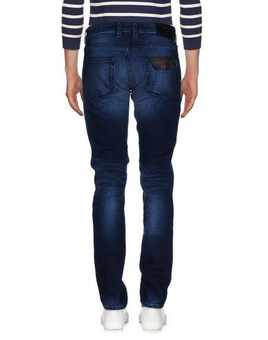 Фото 2 - Джинсовые брюки от MOORER синего цвета