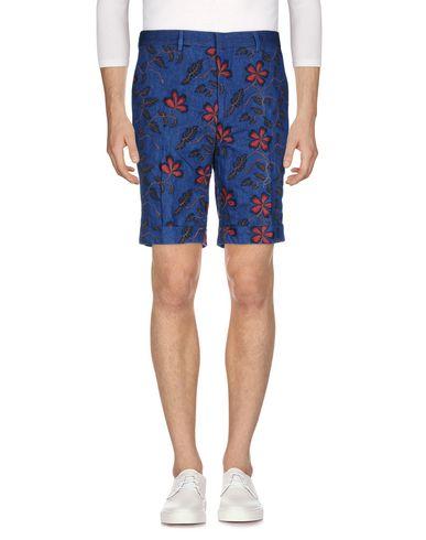 Фото - Джинсовые шорты от BRIAN DALES синего цвета