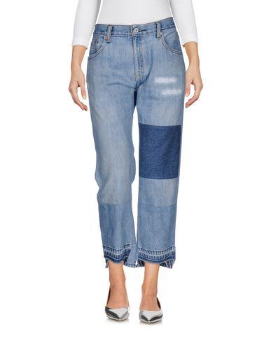 Фото - Джинсовые брюки от NILI LOTAN синего цвета