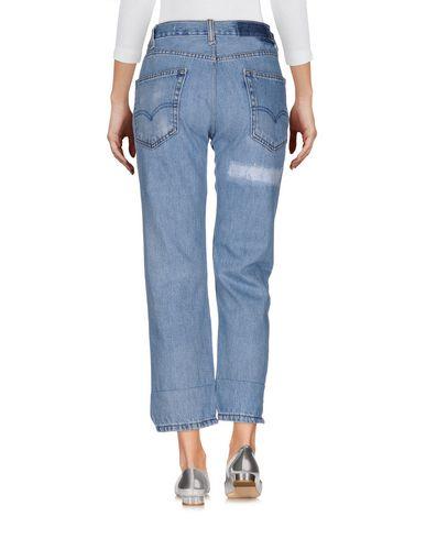 Фото 2 - Джинсовые брюки от NILI LOTAN синего цвета